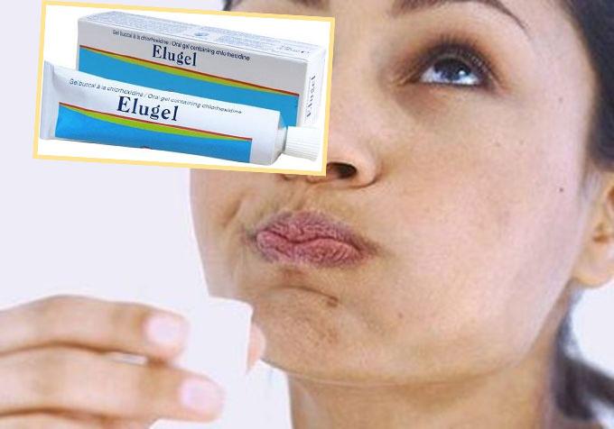 Полоскание рта женщиной и Элюгель