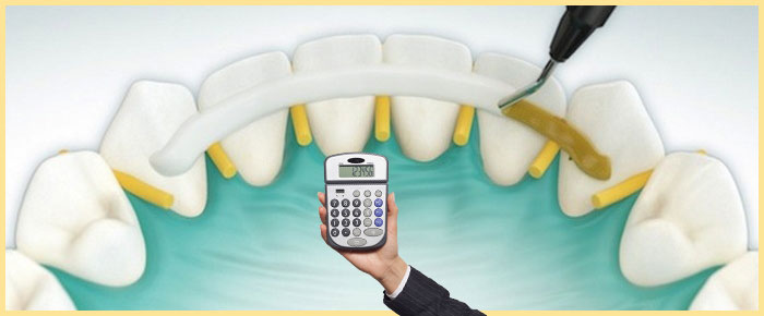 Шины на зубы и калькулятор в руке